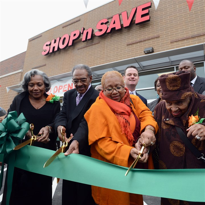 Hill District grocery ribbon-cutting Hill District residents, from left, Pat and Clyde Hefflin, Carolyn Gray, and her mother,105-year-old Lillian Allen, cut the ribbon to open the long-awaited Shop 'n Save on Centre Avenue. The area has been without a grocery store for decades.