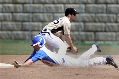 20140419ppCVvKO1SPTS Chartiers Valley's Dominic Castello slides safely into second ahead of the throw to Keystone Oaks' second baseman Ben Canti during their game at Chartiers Valley on April 19.