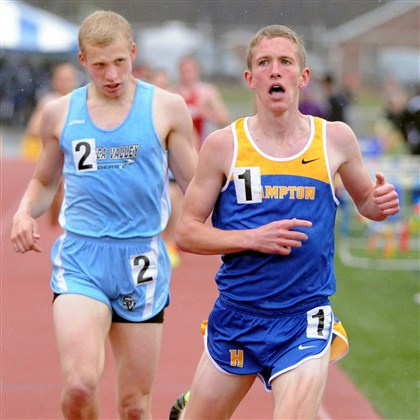 20140425JHSportsTrack01.jpg Hampton's Nate Sloan, right, beats Seneca Valley's Brett Foster to the finish line to win the 1,600-meter run with a time of 4:21 at the Mars Invitational last Friday.