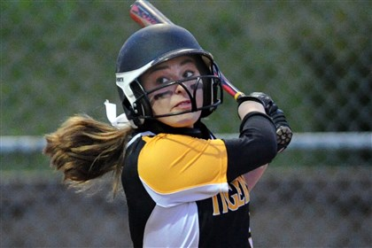 20140422JHSportsSofball07.jpg Sophomore Liz Scherer, who platoons at catcher, swings a potent bat for the North Allegheny Tigers.