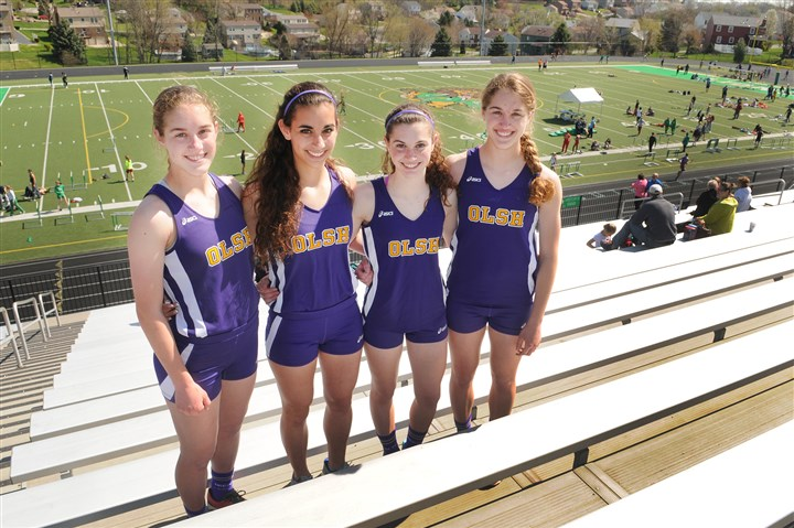 20140426CMSouthFayetteInvit.7.jpg The Lohmann sisters -- Anna, Angela, Maria and Monica -- make up the 400-meter realy team for Our Lady of the Sacred Heart's track team.