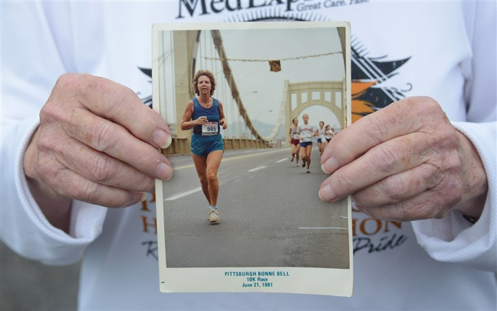 20140430lfMarathon Sports02-1 Ella Jane Custer holds a picture of her running a Pittsburgh 10K in 1981.