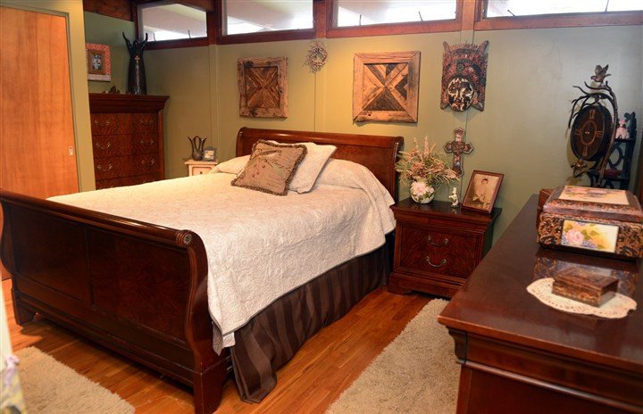 bedroom features high level windows and hardwood floors The bedroom features high level windows and hardwood floors.