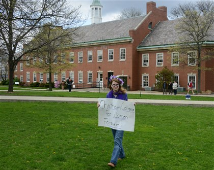"20140501dsChathamLocal03-1 Ashley Bittney of Irwin carries her sign in the ""Free Speech Zone"". Ashley is a Junior at Chatham University."