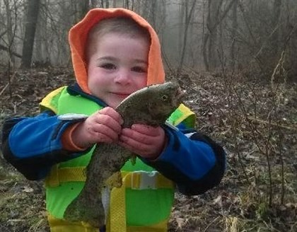 Adrian Jerabek, 3, of Robinson with his first trout. Adrian Jerabek, 3, of Robinson with his first trout.