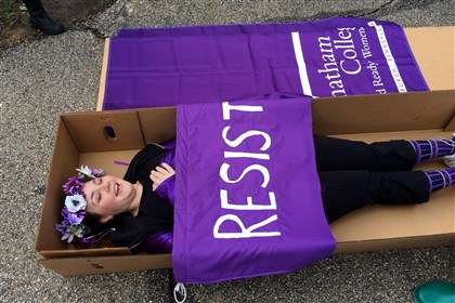 20140501dsChathamProtest01 Charity Pitcher-Cooper of California lies in a coffin during a protest at Chatham University. The university established a free speech zone for those protesting the university's proposal to allow men in the undergraduate program.