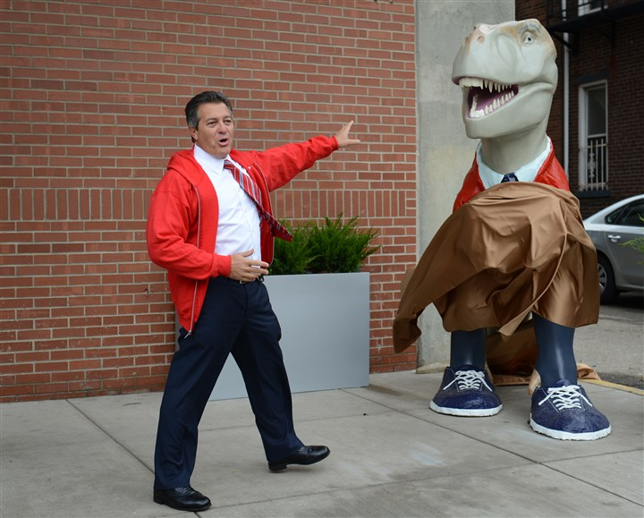 Fredasaurus Rex unveiling Aaron Stauber of Rugby Realty was just about to unveil the Fredasaurus Rex outside of 2100 Wharton Street, when the wind did it for him, Thursday on the South Side.