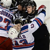 Beau Bennett takes a roughing penalty on a hit on Daniel Carcillo, then with the New York Rangers, in the second period of Game 1 of the second round of the Stanley Cup Playoffs May 2 at Consol Energy Center.