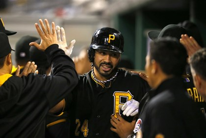Pedro Alvarez celebrates Pedro Alvarez celebrates with teammates after hitting a home run in the ninth inning against the Blue Jays at PNC Park Friday night.