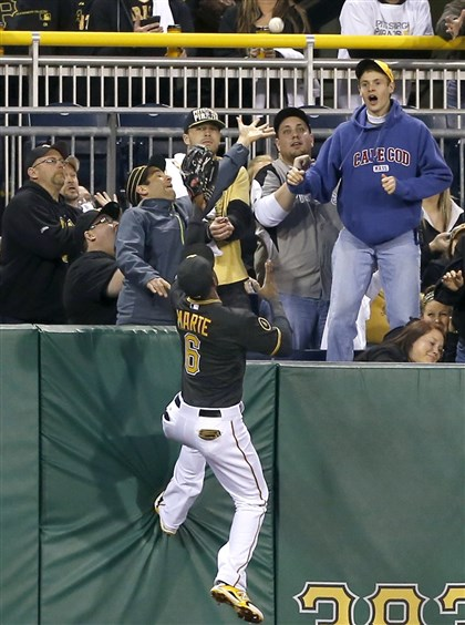 Left fielder Starling Marte climbs the wall  Left fielder Starling Marte climbs the wall chasing the ball as fans reach for the home run ball hit by Jays' Colby Rasmus in the fourth inning at PNC Ppark Friday night.