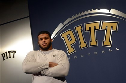 Aaron Donald of Pitt University of Pittsburgh football player Aaron Donald poses for a portrait inside the team's South Side facility on Friday, Dec. 13, 2013.