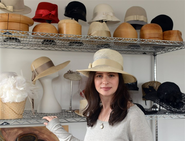 2014428RARmaghat1-5 Jennifer Copeland wears one of her hand-painted hats in her studio in Squirrel Hill.