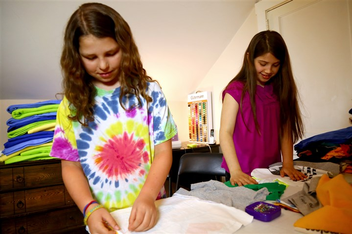 Yonas Kerstetter Jefferson Awards Annie Yonas, left, and Griffin Kerstetter work on quilts for the homeless in the sewing room of Griffin's grandmother's house in Squirrel Hill.