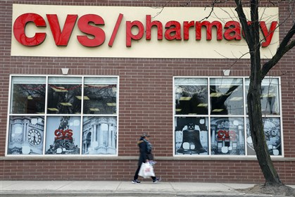 Earns CVS In this March 25, 2014 photo, a pedestrian passes a a CVS store in Philadelphia. CVS reports quarterly earnings on Friday, May 2, 2014. (AP Photo/Matt Rourke)