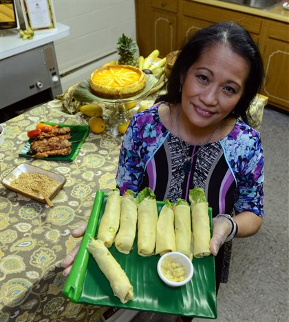 20140503bwFilipinoFood03-2 Carmen Shively with Lumpia Sariwa (Fresh spring rolls), Filipino food, in the kitchen of Homeville Christian Church in West Mifflin. These will be served at the Pittsburgh Folk Festival.