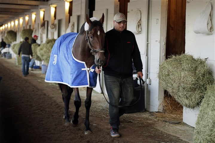 Kentucky Derby Horse Racing Kentucky Derby entrant Wicked Strong is walked after a morning workout at Churchill Downs Friday in Louisville, Ky.