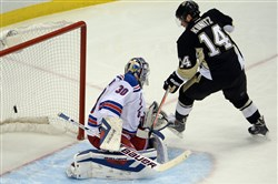 Chris Kunitz, seen here against the Rangers Henrik Lundquist last May, returns to the lineup tonight against the Florida Panthers.
