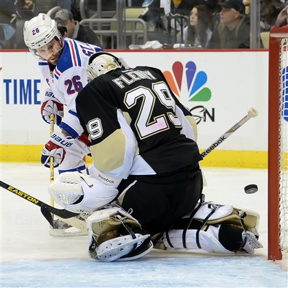 20140504pdPenguinsSports08-1 Penguins goalie Marc-Andre Fleury makes save on the Rangers' Martin St Louis in the second period at Consol Energy Center.
