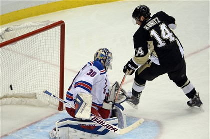 20140504mfpenssports06-1 The Penguins' Chris Kunitz watches a goal by Kris Letang get by Rangers goaltender Henrik Lundqvist in the second period of Game 2 of the Eastern Conference semifinals at Consol Energy Center.