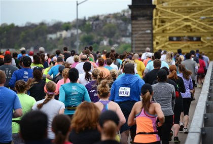 20140504jrMarathonLocal12-3 Runners head to the North Side during the 2014 Pittsburgh Marathon Sunday, May 4.