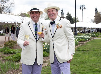 "Spring Hat Luncheon David Bush with Tim McVay toast together in matching Paul Stuart suits. ""The funny thing is, we didn't have to go shopping for this. We had them already in our closets,"" said Mr. McVay laughing."
