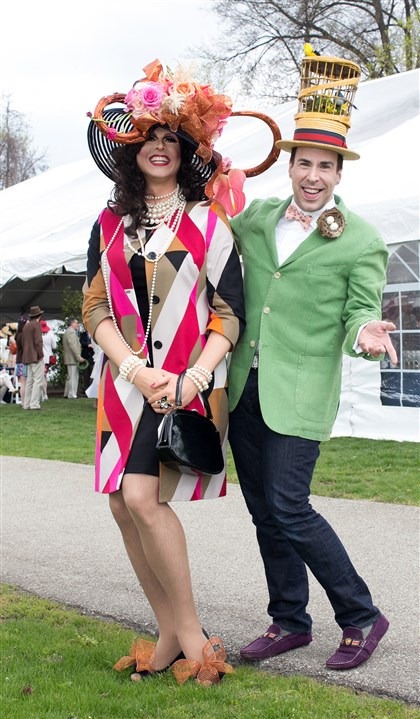 Spring Hat Luncheon Bunny Bixler with Joe King bring the fun to the luncheon in their over-the-top ensembles. #SEENhavingfun