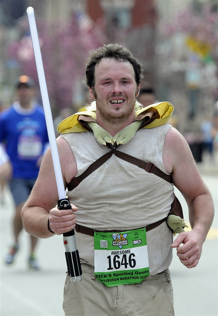 "Runner wears 'Star Wars' gear for Pittsburgh Marathon Zack Morgans ran the race with a ""Star Wars"" lightsabre and a Yoda doll strapped to his back."