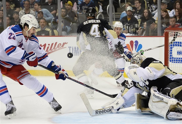 20140504pdPenguinsSports05-5 Penguins' goalie Marc-Andre Fleury makes save on the Rangers' Brian Boyle in the second period of Game 2 at the Consol Energy Center Sunday night.