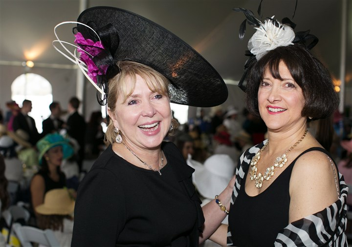 Spring Hat Luncheon Ann Metz with Janet Ferris have a laugh before lunch is served.