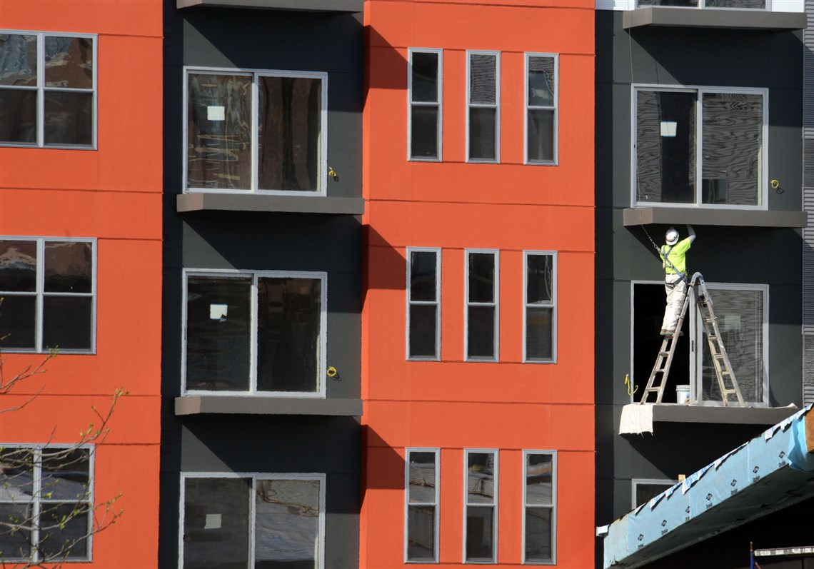 A Worker Puts The Final Touches On A Balcony At Bakery Square 2.0, The  Addition. 1. Local Apartment Rental ...