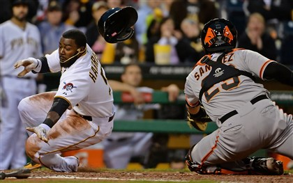 20140505mfbucssports06-2 Pirates' Josh Harrison slides safely into home plate against Giants' Hector Sanchez in the third inning at PNC Park Monday night.