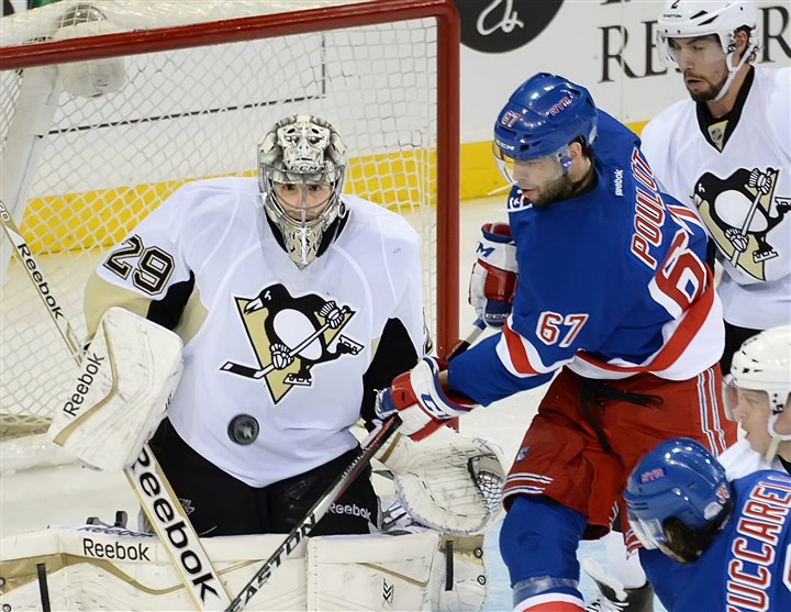 20140505pdPenguinsSports08 Penguins goalie Marc-Andre Fleury makes save on the Rangers' Benoit Pouliot in the second period Monday night at Madison Square Garden in New York.