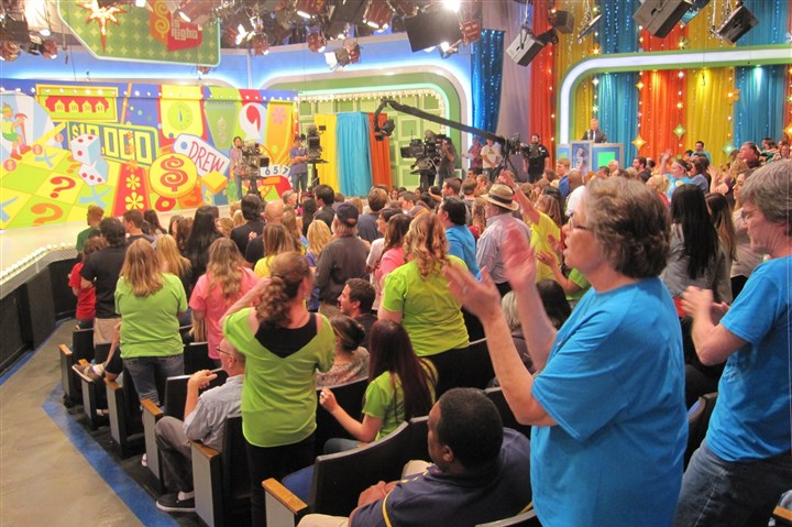 20140505GAMESHOWS2-1 Audience members for The Price is Right have fun during a commercial break.