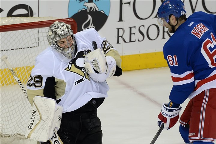 Penguins goalie Marc-Andre Fleury  Penguins goalie Marc-Andre Fleury makes save on the Rangers Rick Nash in the second period Monday night at Madison Square Garden in New York City.