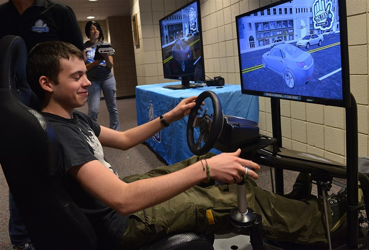20140505lrtextdrivelocal03-1 Narayan Thompson, 17, a junior at Upper St. Clair High School, reacts Monday after he was unable to stop his simulator during a text-and-drive session.