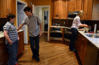 Rachel Blaufeld makes lunch Rachel Blaufeld makes lunch Tuesday for her sons, Blake, left, and Jackson at their Point Breeze home.