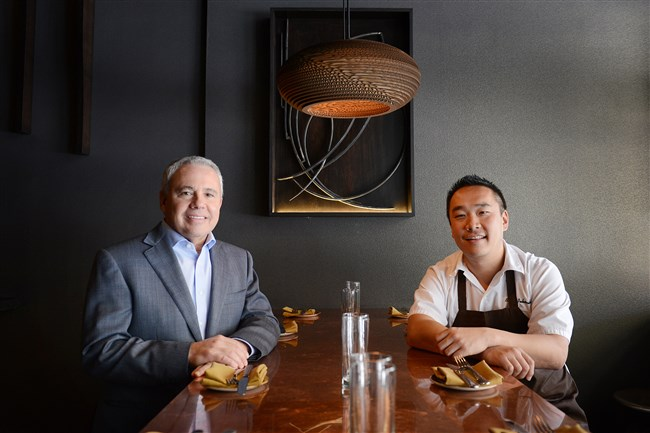 In this 2014 photo, co-owners Rick Stern, left, and Brian Pekarcik sit at their Downtown restaurant Grit and Grace, which was later renamed G&G Noodle Bar.