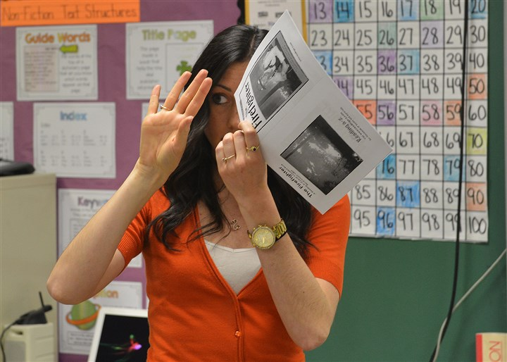"20140506lrfairlesslocal09-12 Emily Kirk, a fifth-grade teacher at Fairless Elementary School in North Braddock, tries to create an expression to remember the word ""brutal"" during a vocabulary-building exercise."