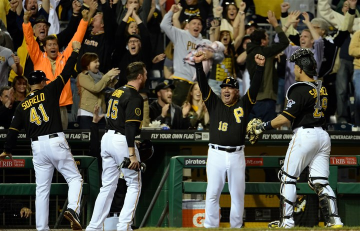 20140506mfbucssports12-1 Pirates' Rick Sofield, Ike Davis, Nick Leyva and Tony Sanchez celebrate after a call at home plate was reversed and the team earned a win against the Giants in the ninth inning at PNC Park on Tuesday night.