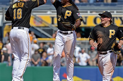 20140507mfbucssports07-4 Pirates' Neil Walker, Andrew McCutchen and Travis Snider celebrate after defeating the Giants at PNC Park.