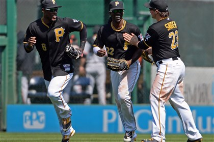 20140507mfbucssports08-5 Pirates' Starling Marte, Andrew McCutchen and Travis Snider celebrate after defeating the Giants at PNC Park.