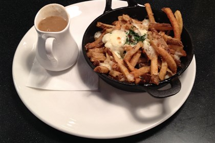 20140508GiglerMunch2-1 The Montreal poutine frites with side of pan gravy at the Blue Line Grille, Uptown.