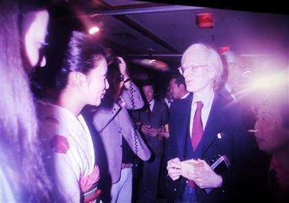 "Andy Warhol visiting Japan in 1974 A photo of Andy Warhol visiting Japan in 1974 is part of the ""15 Minutes Eternal"" exhibit."