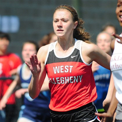 20140426CMSouthFayetteInvit.4.jpg West Allegheny's Lauren Costa approaches the finish line during the 100-meter dash at the South Fayette Invitational on April 26.