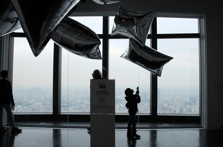 "Warhol silver balloons at the Mori Art Museum  The famous Warhol silver balloons at the Mori Art Museum overlooking Tokyo. The exhibit is part of ""Andy Warhol: 15 Minutes Eternal."""