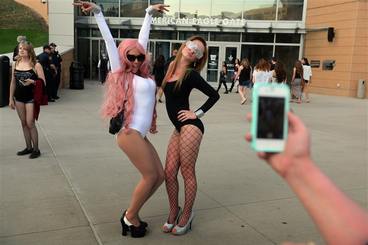 20140508bwGagaMag03a-2 Lada Gaga concert-goers Stefani Zurawski, 25, left, and her sister Lauren Zurawski, 21, both of Finleyville, are dressed to impress outside of Consol Energy Center.