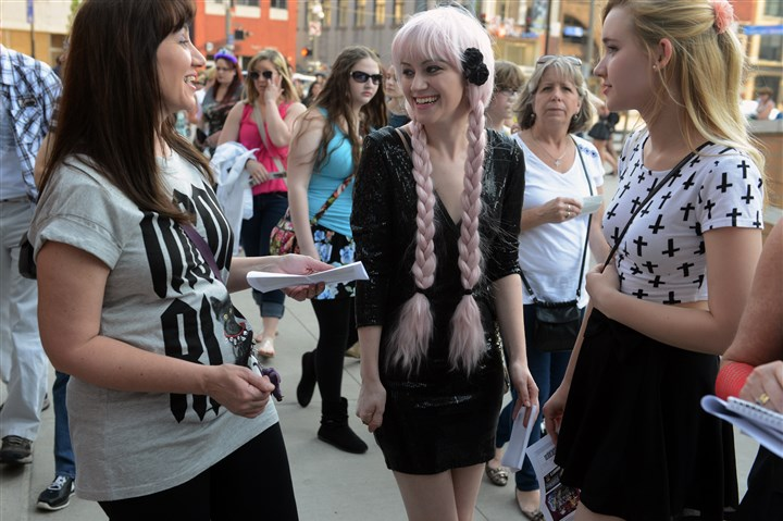 20140508bwGagaMag06-2 Janet Mullins, left, of Sewickley, with her daughters, Christine, 21, and Gillian, 14, are among the Little Monsters attending Lady Gaga's ARTPOP Ball Tour concert in Pittsburgh.