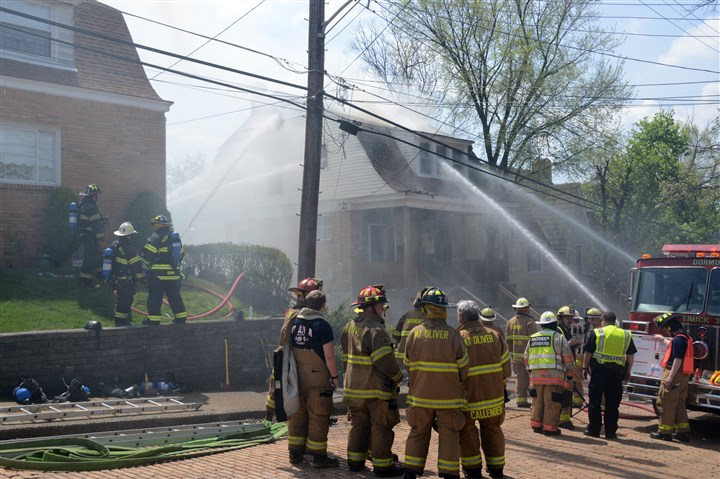 20140508dsDormontFireLoc04-3 Firefighter battle a four-alarm house fire this morning in Dormont.
