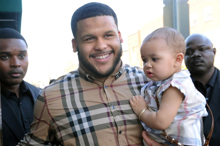 Aaron Donald University of Pittsburgh defensive tackle Aaron Donald enters Savoy Resturant in the Strip District earlier this evening, holding his year old daughter, Jaeda, to await the NFL draft.