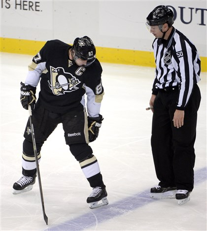 Sidney Crosby tries to show linesman Scott Cherrey Sidney Crosby tries to show linesman Scott Cherrey that he was onside after the whistle blew in the first period at Consol Energy Center Friday night.